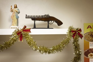 gun on shelf with tinsel underneath
