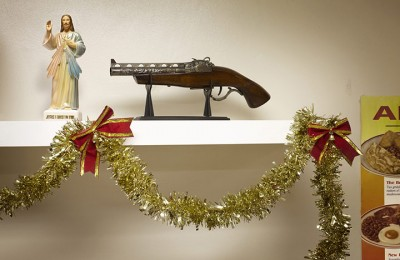 gun on shelf with tinsel underneath